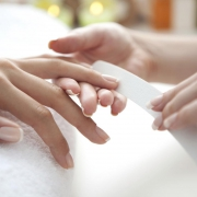 Hands getting a manicure